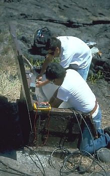 Electronic technicians installing new seismic station